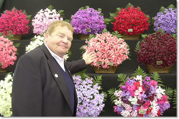 Geoff Hughes admiring the new sweet pea named after him, which was released at Chelsea Flower Show in 2009